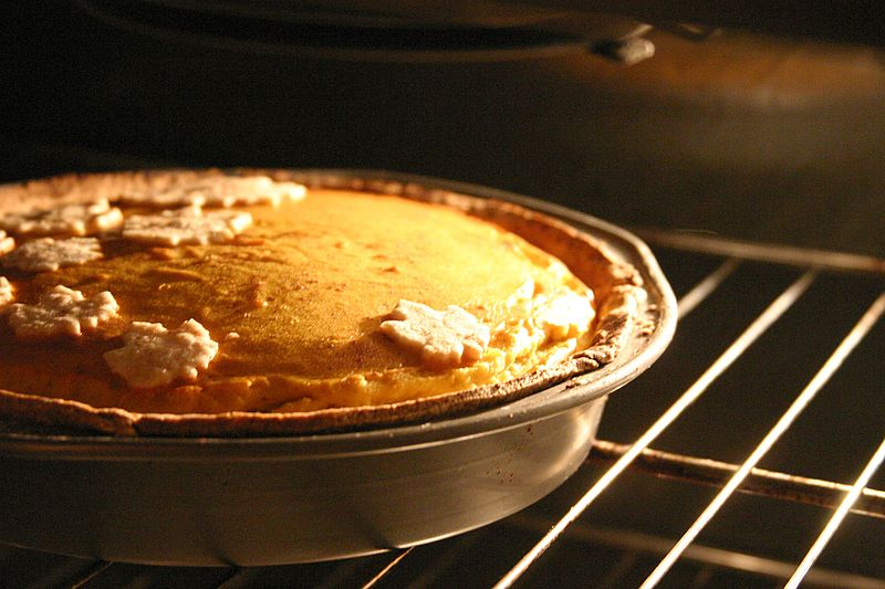 Pumpkin pie with maple leaf decoration baking, October 2006